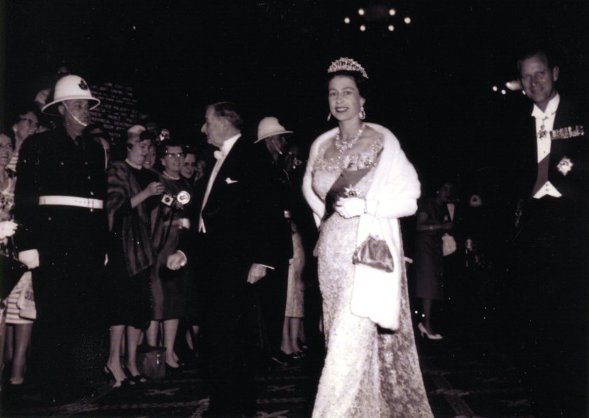 1959 Queen Elizabeth and Price Phillip at Chateau Frontenac (notice ADPi with diamond- shaped nametag in background)